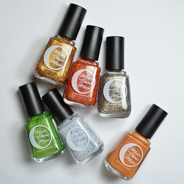 nail polish colors in bottles as a flat lay