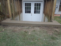 Poured top new concrete step. Provided retaining wall for rain water.