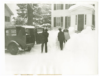 Removing victim from scene of Dartmouth tragedy. Authorities shown removing the body of Edward Moldenke from the Theta Chi fraternoty house at Hanover, NH February 26, where he and eight of his fraternoty brothers were killed the night of February 26 by carbon monoxide poisoning. Investigation revealed that a slight explosion in the furnace had broken the flue pipe and allowed the fumes fo the gas to penetrate the basement and upper floors fo the house, killing the men in their sleep. Associated Press Photo From New York please use credit.