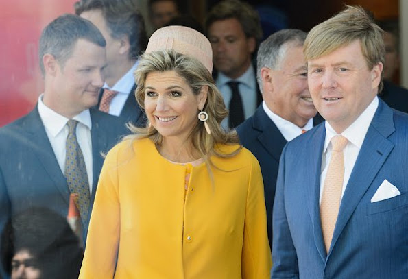 Queen Maxima wore Natan coat in yellow, wore Natan Dress in pink, Natan pumps, Natan clutch handbags, diamond earrings