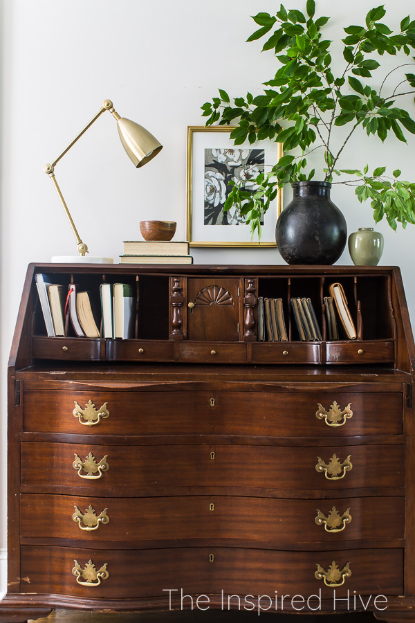 Secretary desk with brass and marble lamp