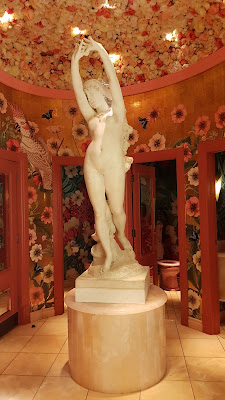 Statue and floral wallpaper at The Ivy in Manchester