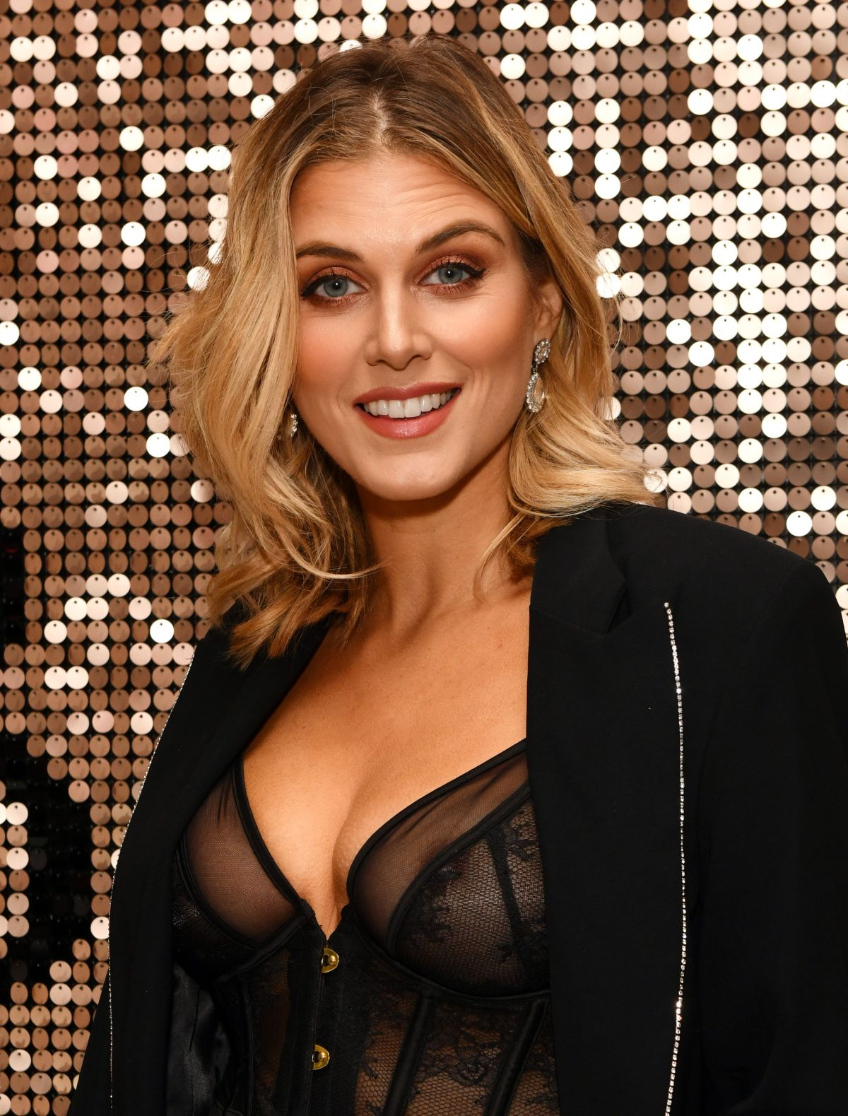 Ashley James leaves little to the imagination as she arrives in sheer basque at the Boux Avenue x Megan McKenna launch