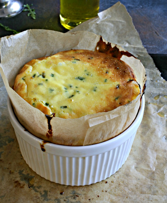 Recipe for a souffle using whole, not separated eggs, and flavored with smoked Gouda cheese.