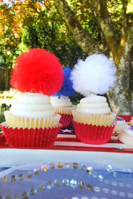 Top your cupcakes with fun tulle poms. Find them at www.etsy.com/shop/fizzyparty