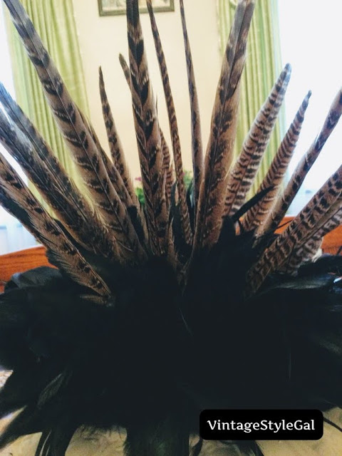 Close up pic of feathers coming out of urn