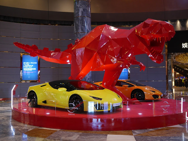 Lamborghinis and Tyrannosaurus sculpture display at City of Dreams Macau