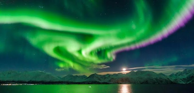 Northern lights in the night sky over Norway. Photo by Jan R. Olsen