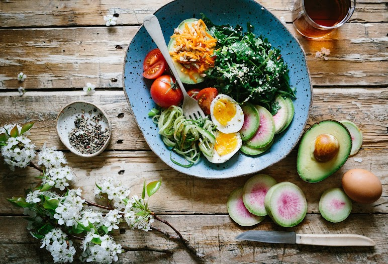 A Plate Of Fresh Salad On Wooden Table