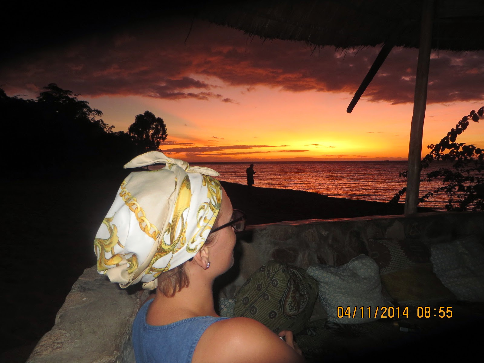Cille, a Norwegian NGO worker in Malawi, taking in sunset at Mango Drift, Likoma Island, Malawi