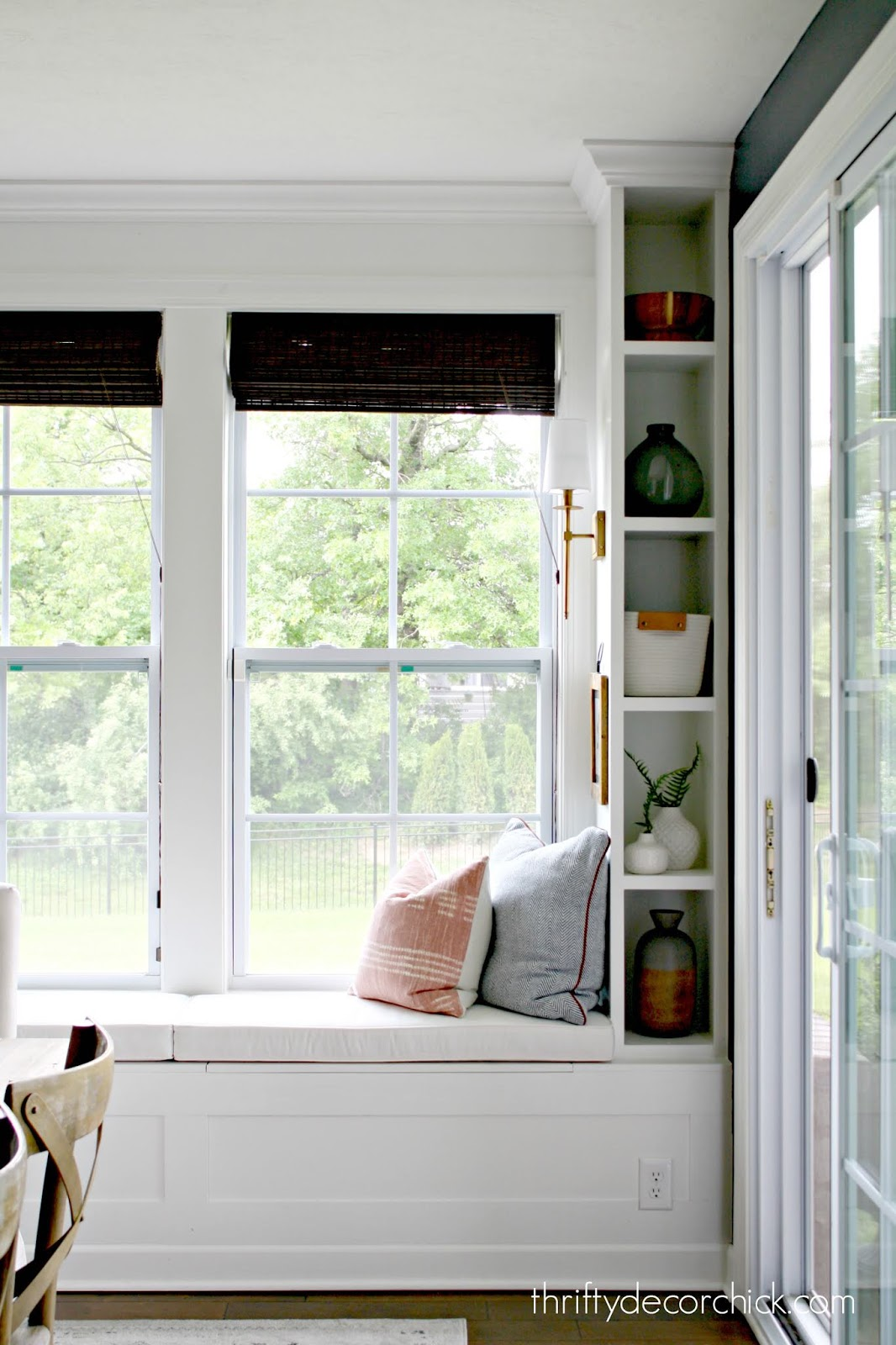 Window seat with bookshelves and lights
