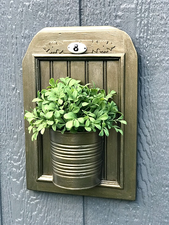Bronze planter from cabinet door