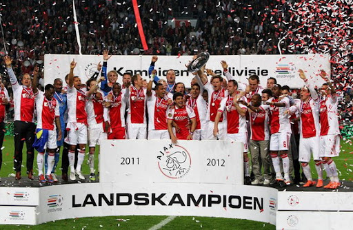 Ajax Amsterdam players celebrate after winning the Eredivisie League title