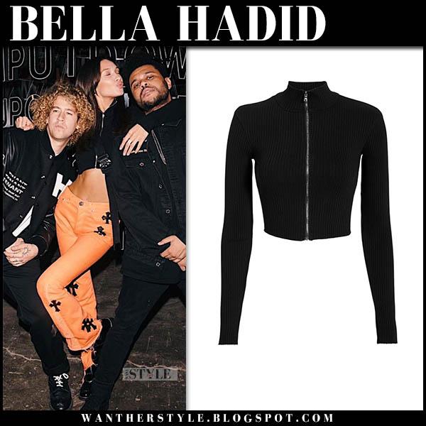 Bella Hadid in black zip crop top and orange pants model casual style november 5