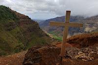 Cross overlooking canyon at Waimea Canyon State Park in Hawaii