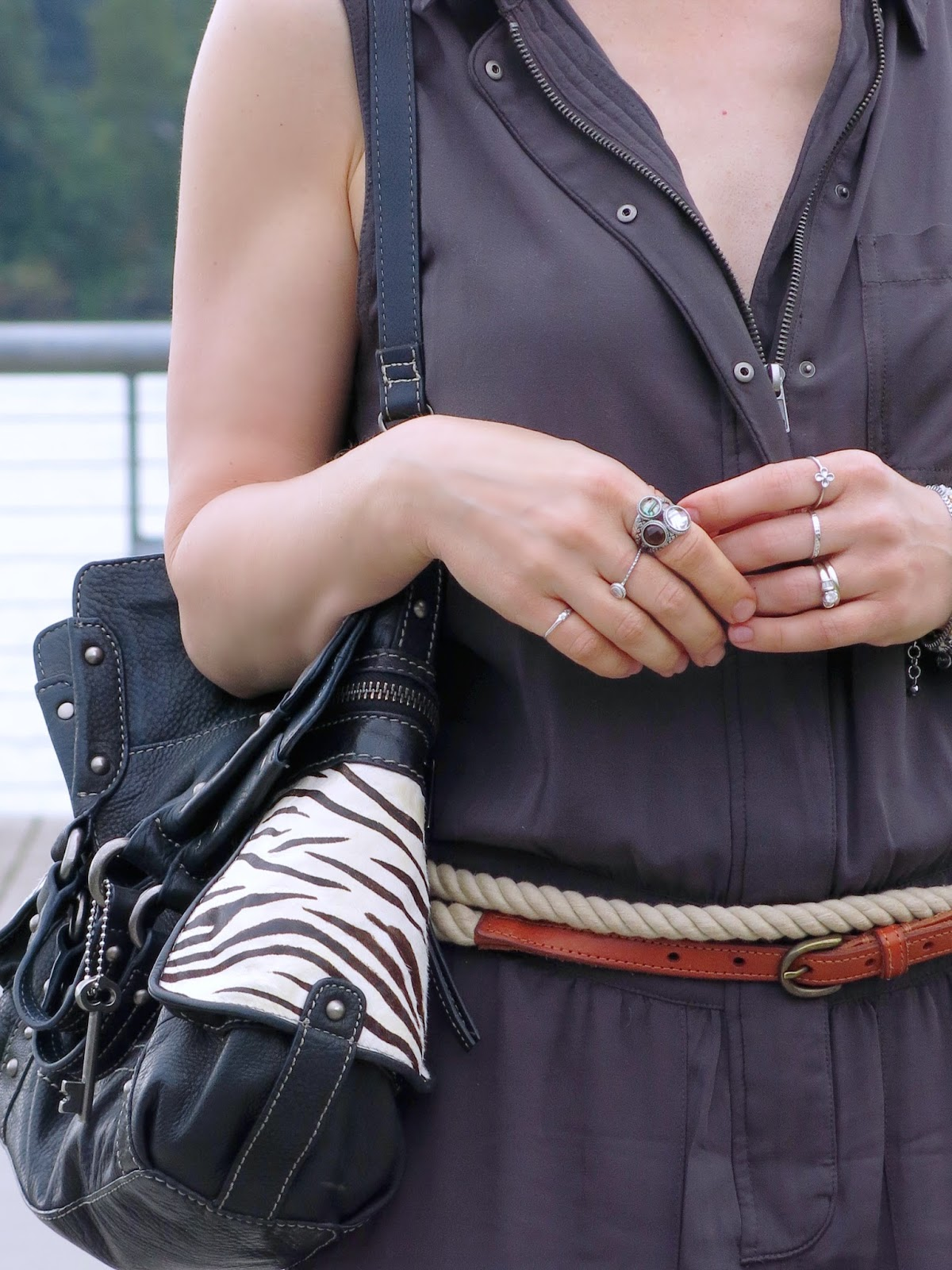 a utility-style jumpsuit, zebra-striped Fossil bag, and accessories