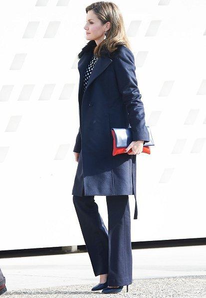 Queen Letizia wore Carolina Herrera blouse and Hugo Boss suit