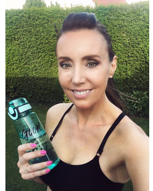 woman fitness with water bottle