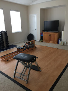 Greatmats wood look vinyl exercise floor tiles over carpet
