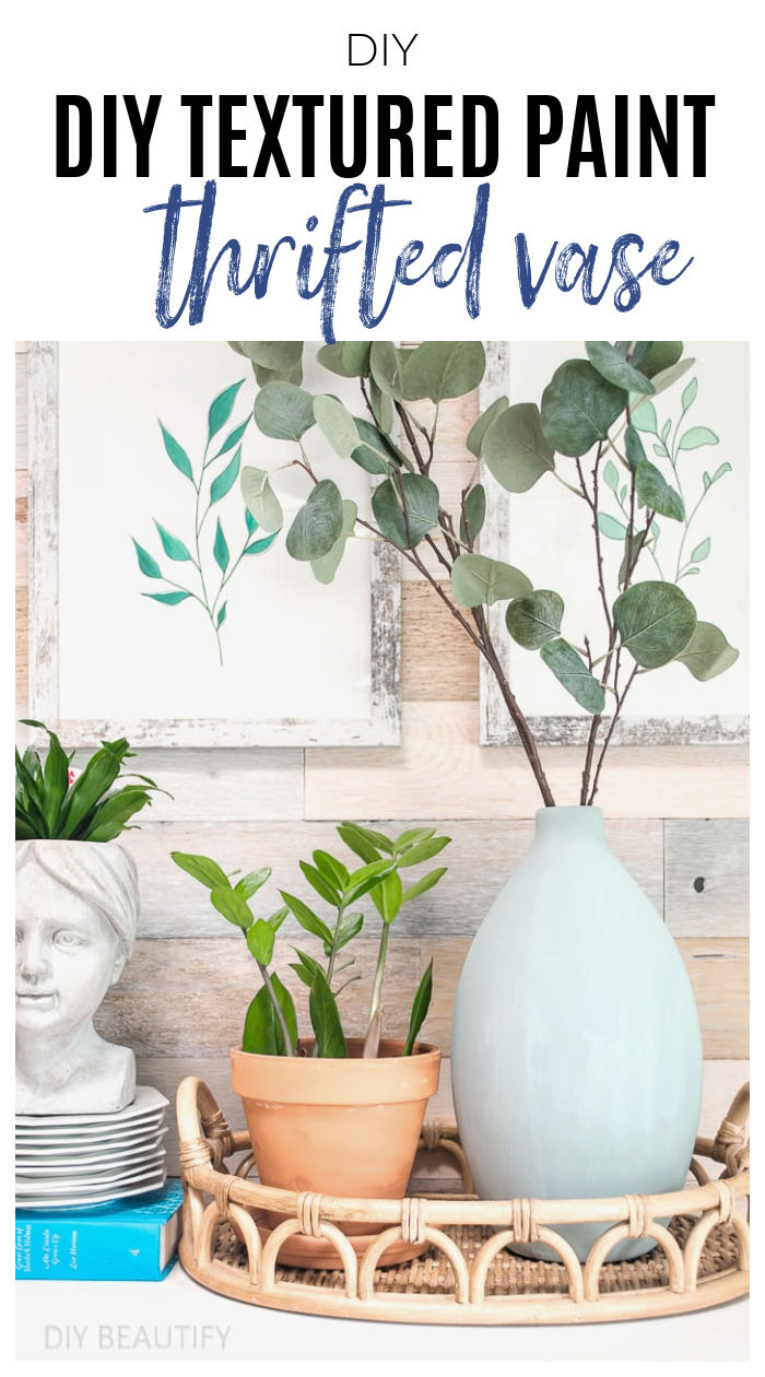 dresser with plants, books and painted vase