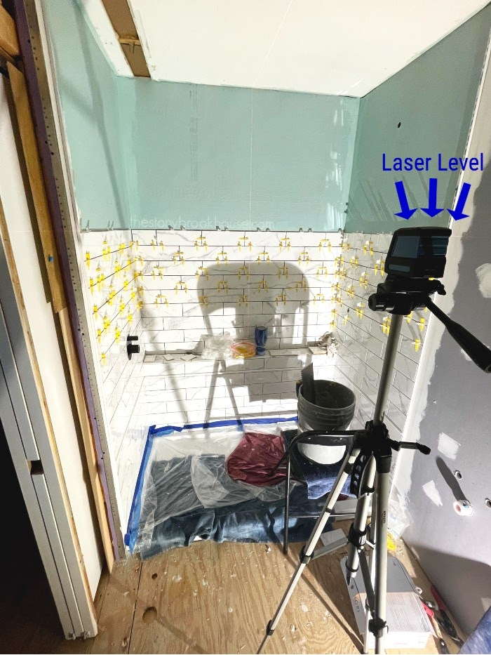 laser level is a must for tiling a shower