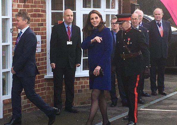 Kate Middleton wore Goat Ellory Bow Detail Coat. Duchess Catherine of Cambridge carried Beulah London Aspinal Blue Heart Clutch