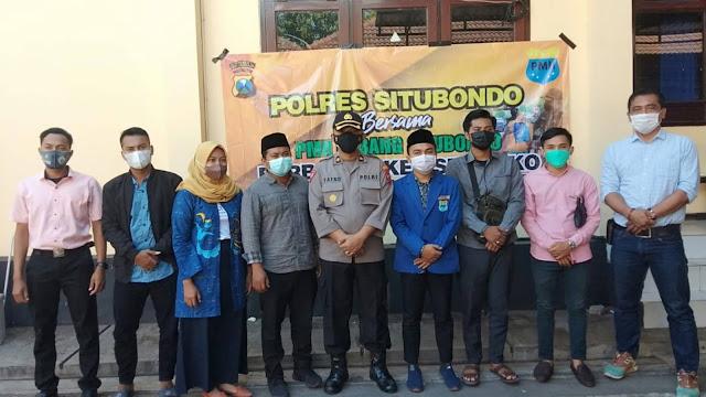Peduli Masyarakat, PC PMII Situbondo Bersama Polres Bagi - Bagi Sembako