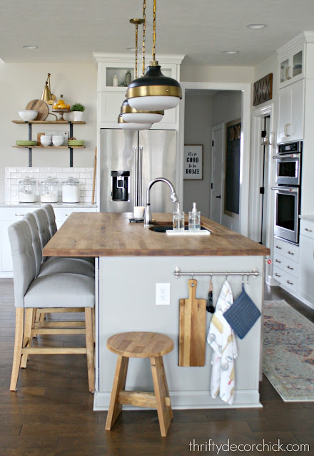 Light gray and white kitchen with wood accents