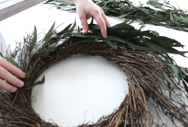 add eucalyptus leaves to twig wreath