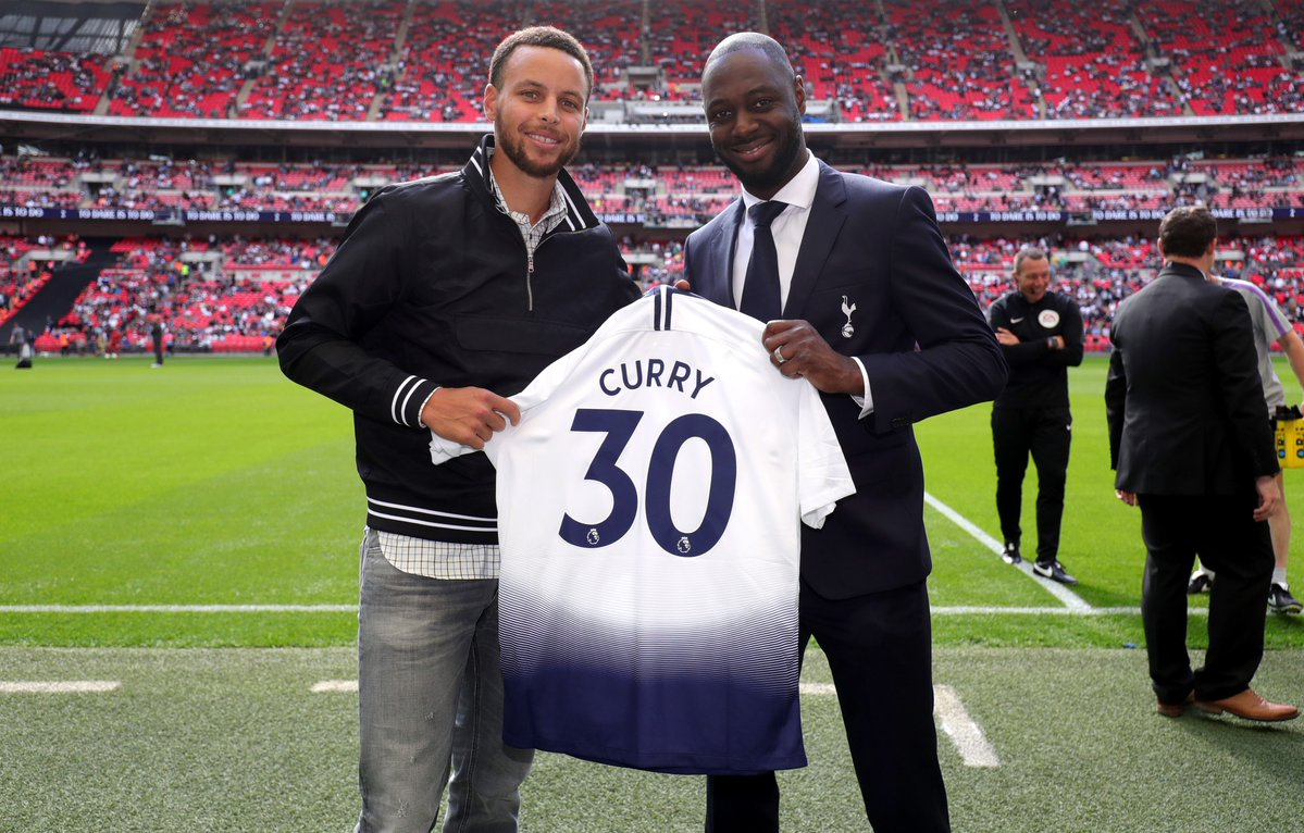 NBA superstar Stephen Curry poses with his own personalised Tottenham Hotspur jersey
