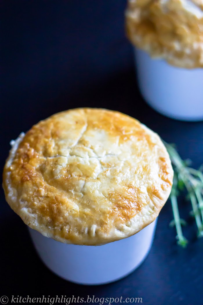 This mini chicken pot pie recipe highlights a creamy chicken stew loaded with fresh peas, potatoes, carrots and onions baked under a rich and flaky crust