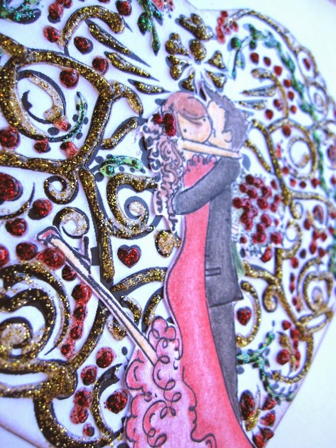 otro detalle de tarjeta de scrapbooking para San Valentín con corazón de filigrana decorado con glitter glue rojo, verde y amarillo y pareja de novios coloreada besándose