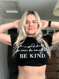 blonde woman in tshirt saying World Where You Can Be Anything Be Kind