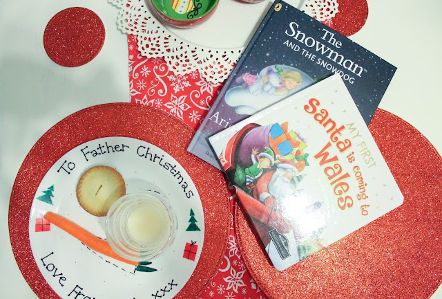 personalised plate for Father Christmas with food and christmas books for bedtime Santa's first visit to Wales