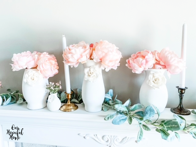 white paper flowers pink peonies vases mantel brass candlestick