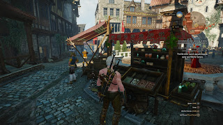 Geralt at the market of Novigrad, looking at some herbs.