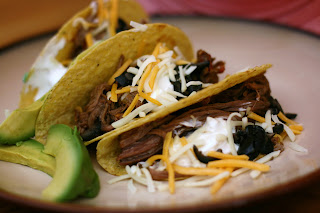 How to make perfect shredded beef in the crockpot to serve at your next Taco Night!!