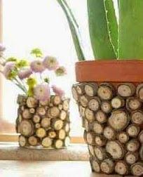 http://manualidadesreciclables.com/16041/personalizar-un-macetero-con-ramas-de-madera