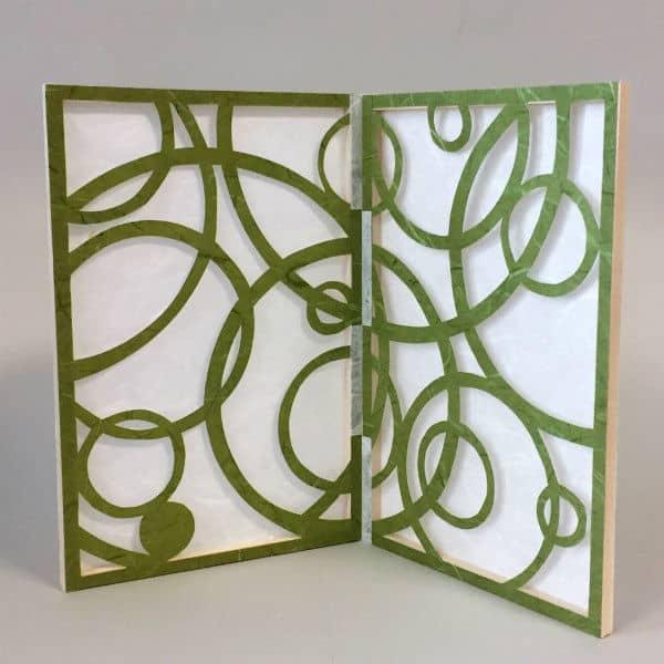 paper stencil screen with cut swirls design