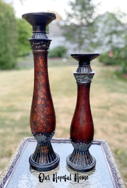 tall brown floor candle holders