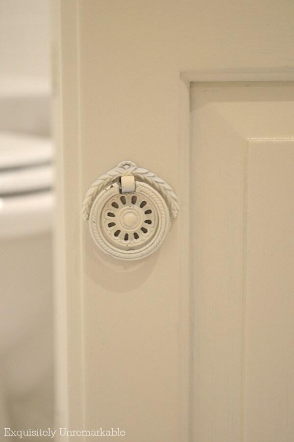 White painted vintage bathroom hardware on ivory vanity