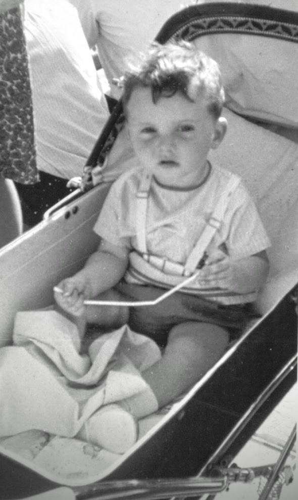 Toddler Mike in a pram