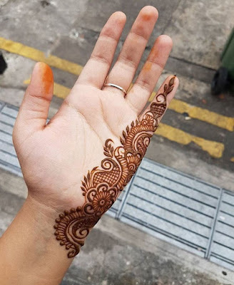 34110a482b71c #63 Unconventional simple mehndi design on one side of hand with lots of  empty space