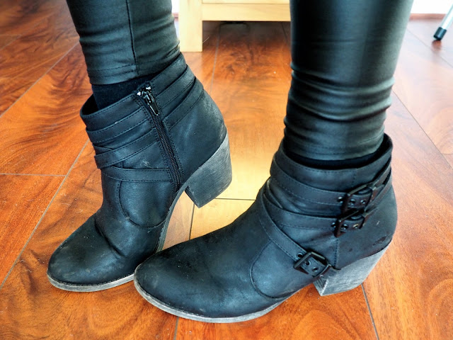 Leather Look | outfit shoe details of black leather high heeled ankle boots with buckled straps, worn with faux leather leggings