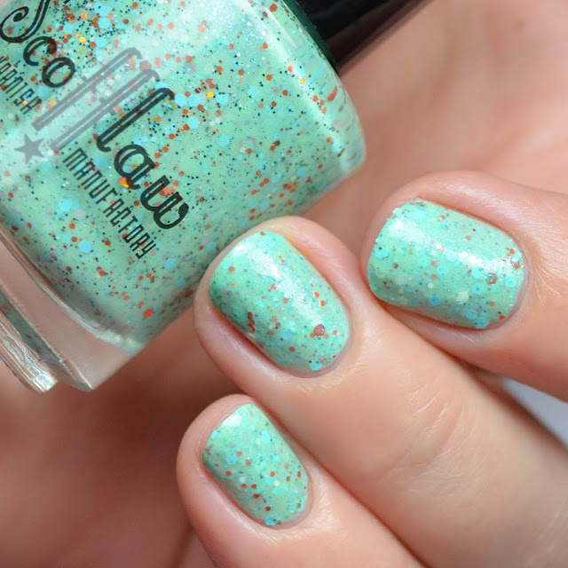 minty nail polish with orange glitter
