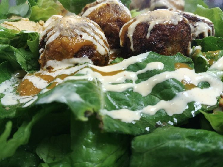 Falafel on a bed of greens at Peppy Olive