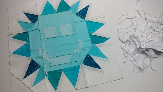 Paper pieced sun quilt block