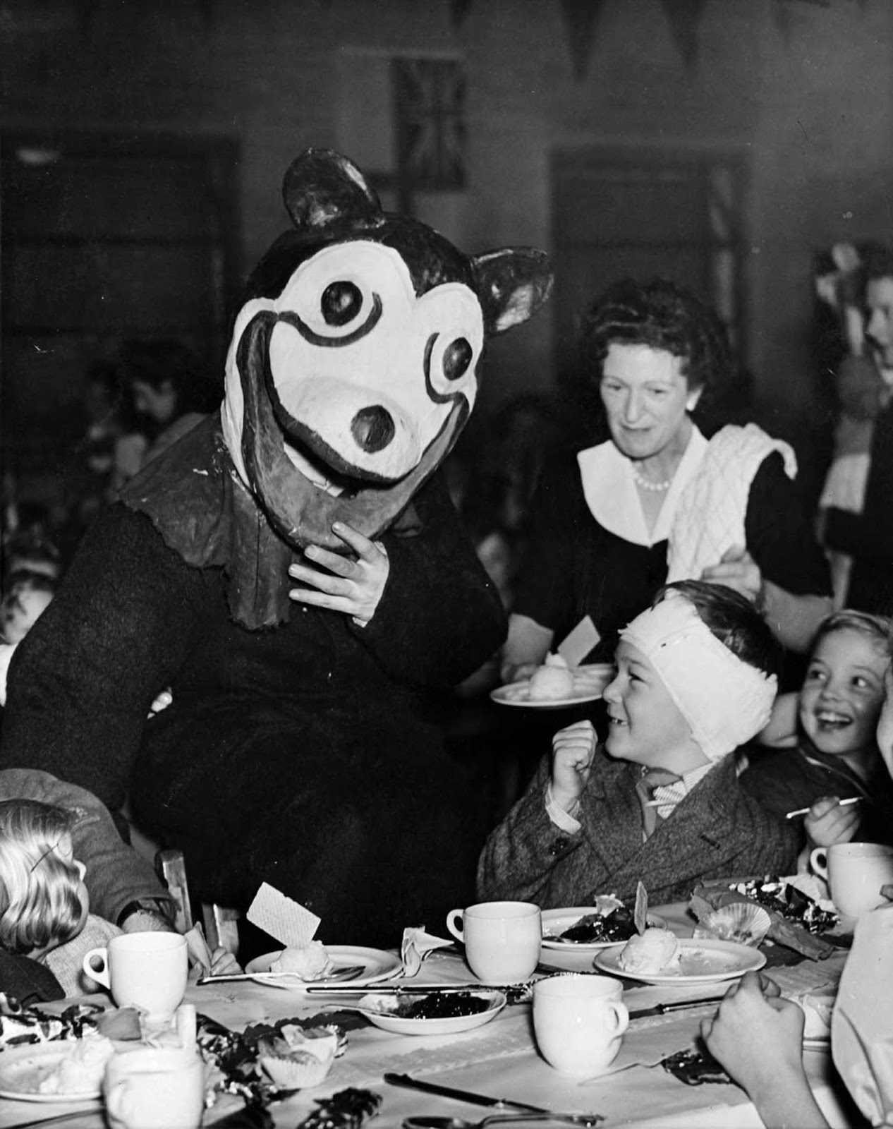 Mickie as a guest at a party given to 350 children by the 562 Battery Searchlight Regt, Streatham, London. 1947.