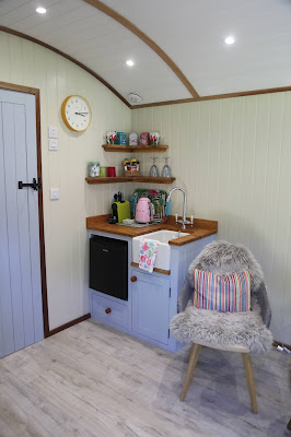 The kitchen inside the Shepherd's Hut at Parkway Hotel and Spa, Cwmbran