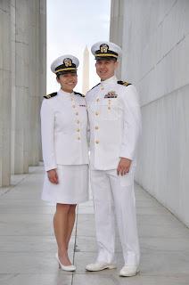 Clara Hua in a white uniform next to a man in a white uniform.